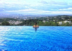 the peak is high-end residential project with views of metro manila skyline and laguna de bay