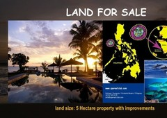 beachfront land titled for sale with improvements