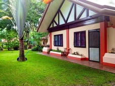 tropical paradise. two houses including guest house on large, seperate titled lots